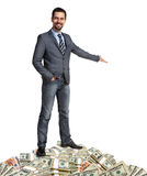 Happy businessman shows the way how to make a lot of money Royalty Free Stock Photos