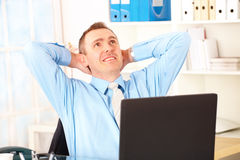 Happy businessman sitting Stock Image