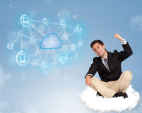 Happy businessman sitting on cloud with cloud computing Stock Image