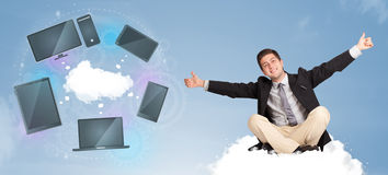 Happy businessman sitting on cloud enjoying cloud network servic Stock Photos