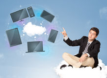 Happy businessman sitting on cloud enjoying cloud network servic Royalty Free Stock Images