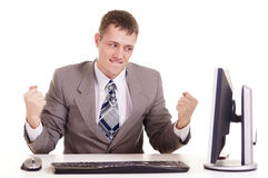 Happy businessman sitting at a computer Stock Image