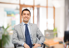 Happy businessman sitting in office chair Stock Photography