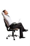Happy businessman sitting Royalty Free Stock Image
