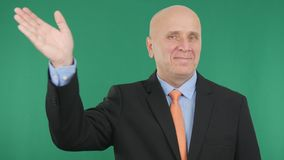 Happy Businessman Smile and Make a Salute Hand Gestures a Welcome Sign. stock photography