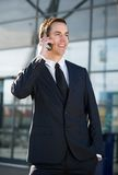 Happy businessman smiling and calling by cellphone Royalty Free Stock Photography