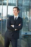 Happy businessman smiling outdoors with arms crossed Royalty Free Stock Photos