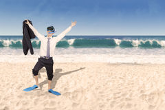 Happy businessman with snorkeling mask Royalty Free Stock Image