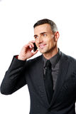 Happy businessman speaking on cell phone Stock Photos