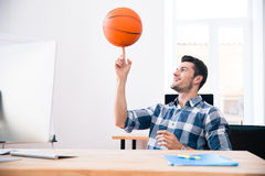 Happy businessman spining ball in office Royalty Free Stock Photo