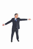 Happy businessman spreading his arms Stock Image