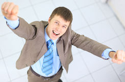 Happy businessman standing Royalty Free Stock Photo