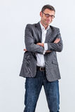 Happy businessman standing with arms crossed for optimism Royalty Free Stock Photo