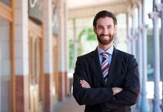 Happy businessman standing with arms crossed Royalty Free Stock Photo