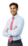 Happy Businessman Standing With Arms Crossed royalty free stock images