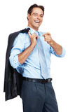 Happy businessman standing casually Stock Photography