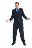 Happy businessman standing clenching his fists Royalty Free Stock Images
