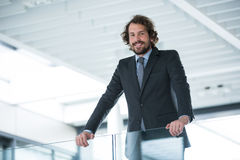 Happy businessman standing in office Royalty Free Stock Image