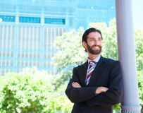 Happy businessman standing outside with arms crossed Royalty Free Stock Images