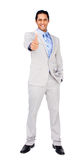 Happy businessman standing with thumb up Royalty Free Stock Photo