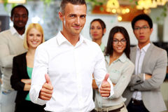 Happy businessman standing with thumbs up Royalty Free Stock Image