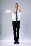 Happy businessman standing with thumbs up Stock Images