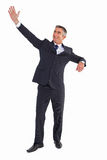 Happy businessman standing and waving Stock Image