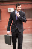 Happy businessman on the street royalty free stock image