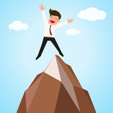 Happy businessman successful ,jumping on top of mountain Royalty Free Stock Photos