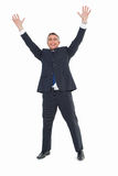 Happy businessman in suit with arms up Stock Photos