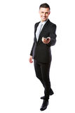 Happy businessman in a suit giving you a smartphone. Over white background Stock Photography