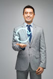 Happy businessman in suit showing circle arrow Royalty Free Stock Image