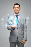 Happy businessman in suit showing global network Royalty Free Stock Photography