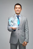 Happy businessman in suit showing globe hologram Stock Photos