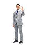 Happy businessman in suit showing ok hand sign Royalty Free Stock Photos
