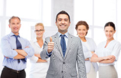 Happy businessman in suit showing thumbs up Royalty Free Stock Photo