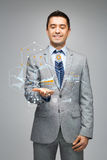 Happy businessman in suit showing virtual screens Stock Photo