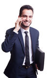 Happy businessman in suit smiling while talking on the phone Royalty Free Stock Image