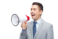 Happy businessman in suit speaking to megaphone Royalty Free Stock Photos