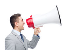 Happy businessman in suit speaking to megaphone Stock Photo
