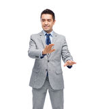 Happy businessman in suit touching something Royalty Free Stock Photos