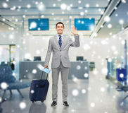 Happy businessman in suit with travel bag Stock Photo