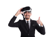 Happy businessman in suit and virtual glasses showing thumbs up isolated on white background. Royalty Free Stock Images