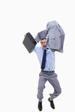Happy businessman with suitcase jumping Stock Photo