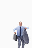 Happy businessman with suitcase about to jump Royalty Free Stock Image