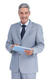 Happy businessman with tablet pc Royalty Free Stock Photo