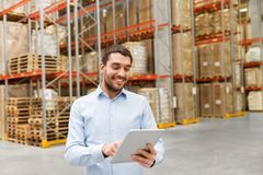 Happy businessman with tablet pc at warehouse Stock Photos