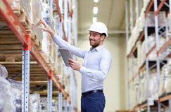 Happy businessman with tablet pc at warehouse Stock Images