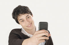 Happy businessman taking a selfie photo with his smart phone. Stock Images