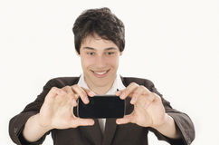 Happy businessman taking a selfie photo with his smart phone. Stock Photography